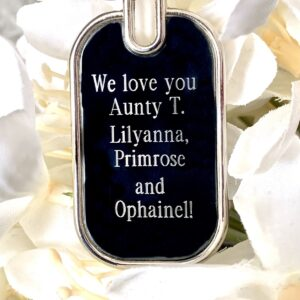 Oval shaped keychain keyring with a text message engraved onto it. personalised gift
