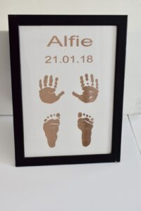 Foil hand and foot prints in a frame with the name and date added. personalised gift product