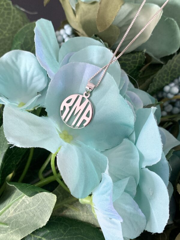 A necklace personalised with initials. letters cut out of metal. personalised necklace. handcrafted jewellery