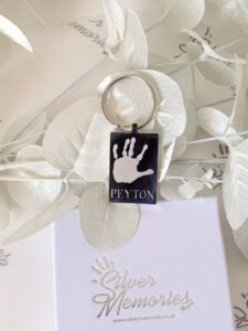 Keychain, keyring engraved with a handprint and a date