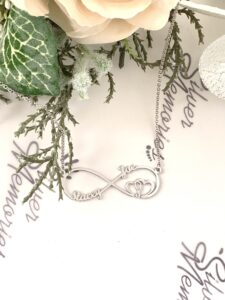 handcrafted necklace with the infinity sign and names crafted onto it