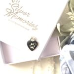 Handcrafted jewellery Pawprint necklace in sterling silver on an open Silver Memories jewellery box